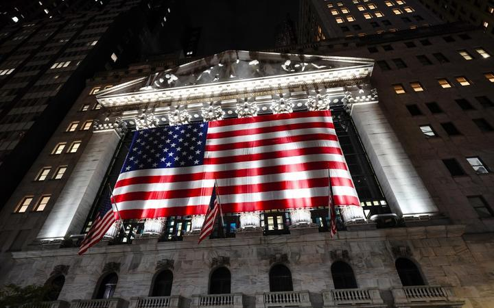A view of the New York Stock Exchange in Wall Street with US national flag on Election Day.