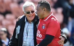 Former All Blacks Sir Bryan Williams and Ofisa Tonu'u catch up after the New Zealand Barbarians Legends v Pacific Legends game in 2019.