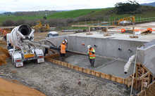 Workers lay down steel for the Huntly Bypass.
