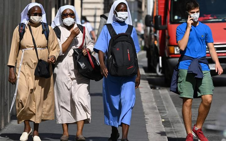 Nuns wearing a face mask walk along the Via del Corso main shopping street in downtown Rome on September 25, 2020 during the COVID-19 pandemic, caused by the novel coronavirus.