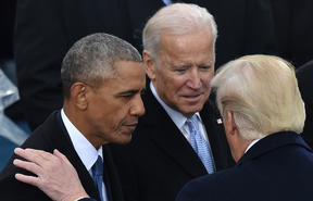 Barack Obama and Joe Biden speak with Donald Trump at his inauguration in January 2017.