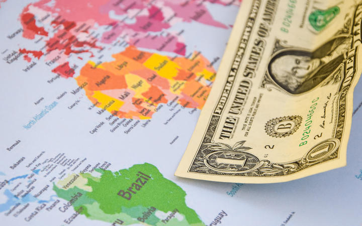US dollar banknotes on globe world map, American investment and trading, concept of american policy and influence