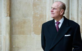 Britain's Prince Phillip, The Duke of Edinburgh, looks at the assembled choir following the annual Commonwealth Day Observance Service at Westminster Abbey in central London, England, on March 14, 2011.