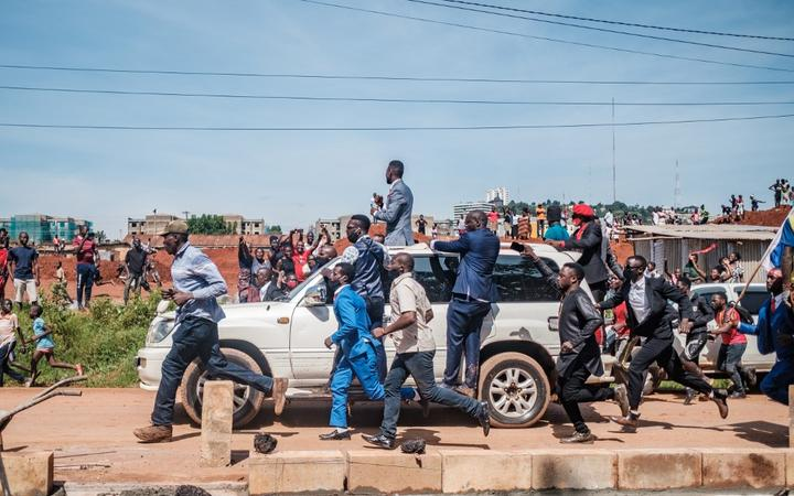 Musician turned politician Robert Kyagulanyi (C top), also known as Bobi Wine, greets supporters as he makes his way to be officially nominated as presidential candidate, in Kampala, Uganda.