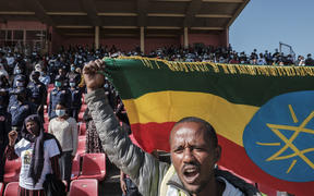 A man holds an Ethiopian national flag during a blood donation rally in Addis Ababa, as hundreds of Ethiopians gathered in the capital on 12 November 2020, to donate blood for troops fighting in the northern Tigray region.