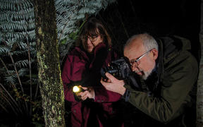 Gillian & Darryl Torckler doing photography in the bush at night.