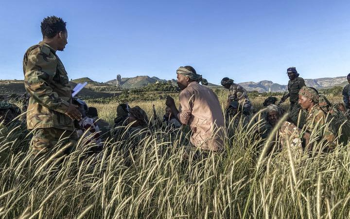 Amhara militia men, that combat alongside federal and regional forces against northern region of Tigray, receive training in the outskirts of the village of Addis Zemen.