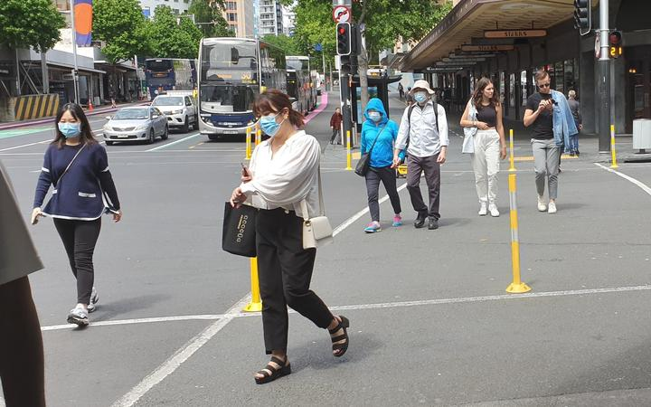 People in Queen Street Auckland, wearing masks.