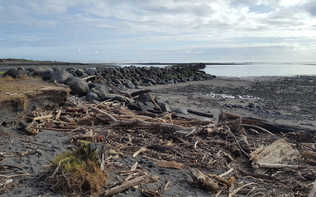"East Beach residents say the Taranaki Regional Council's ""half-tide wall"" is directing storm surges towards their homes."