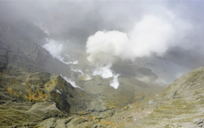 View on 16 November 2020 of steam, gas and ash emission from the 2019 primary vent area of the Whakaari/White Island crater.