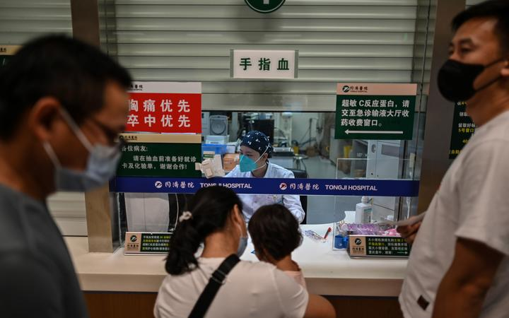 A medical worker conducts blood testing on patients in Tongji Hospitai, in Wuhan on September 3, 2020, while local authorities made a visit with media to the hospital.