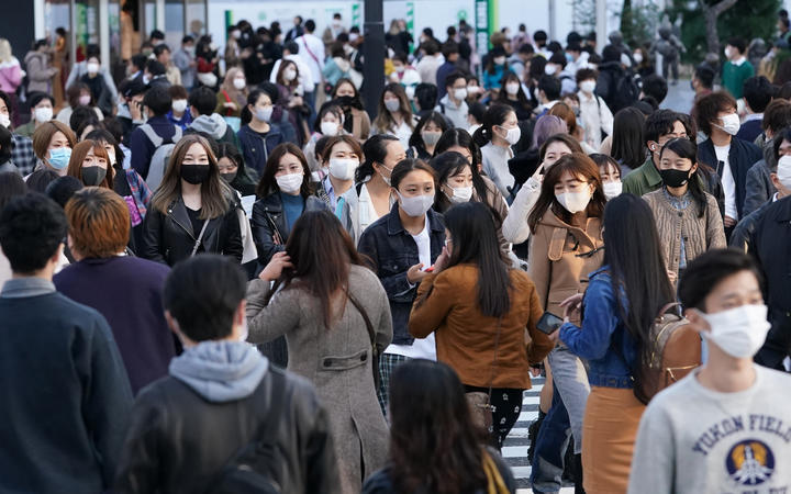 Many people wearing masks are seen at Shibuya scramble crossing in Tokyo on November 15, 2020.