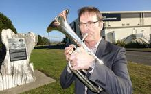 Nelson brass musician Mike Ford practises tenor horn near the airport walkway during his tea breaks at work.