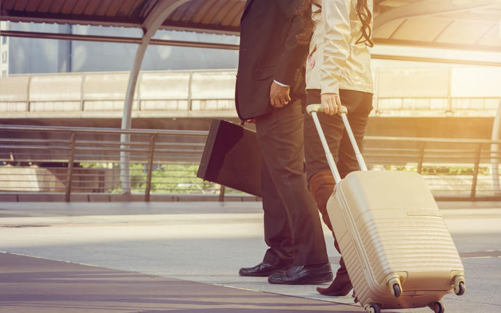 Businessman and businesswoman traveler with luggage at city background, Business People Commuter Walking City Life Concept.