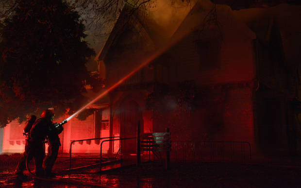 Firefighters tackle the blaze at Christchurch's 152-year-old Risingholme Community Centre.
