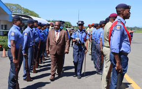 PNG police attend to Prime Minister James Marape as he arrives in Alotau for an official visit to Milne Bay province, 22 August 2020.