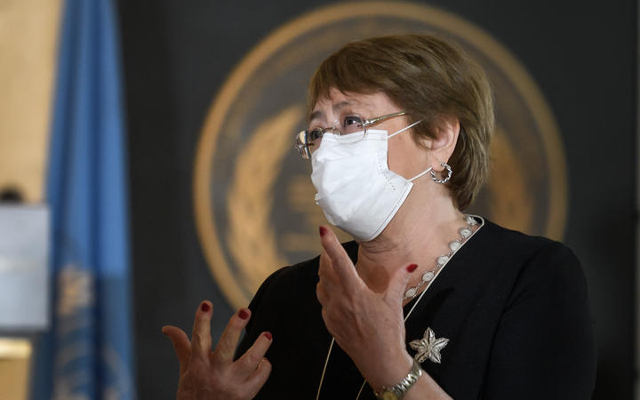 UN High Commissioner for Human Rights Michelle Bachelet wears a protective face mask as she attends 2020 World Humanitarian Day.