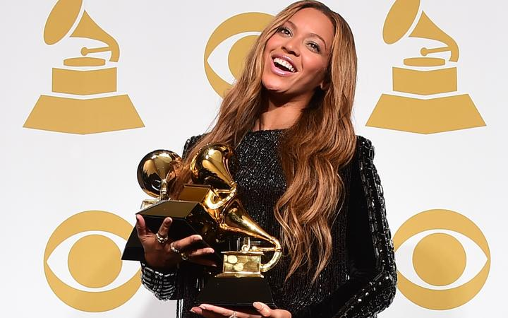 Beyoncé poses with her three Grammys during the 57th annual Grammy Awards in 2015.