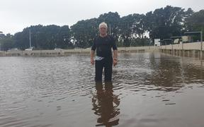 Spud Andrews takes a stroll across the flooded Paritutu Bowling Club greens.