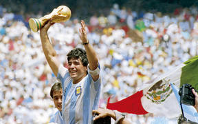 Diego Maradona of Argentina holds the World Cup trophy after defeating West Germany 3-2 during the 1986 FIFA World Cup Final match at the Azteca Stadium on June 29, 1986 in Mexico City, Mexico.