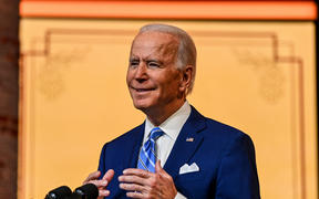 US President-elect Joe Biden delivers a Thanksgiving address at the Queen Theatre in Wilmington, Delaware.
