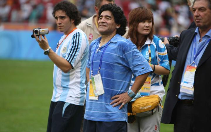 Diego Maradona celebrates after the men's soccer team of Argentina won the gold medal at the Beijing 2008 Olympic Games.