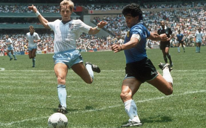 Argentinian forward Diego Maradona gets ready to cross the ball under pressure from English defender Gary Stevens during the World Cup quarterfinal soccer match between Argentina and England on June 1986.