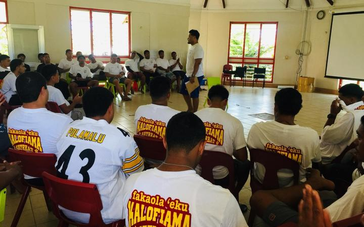 Tongan high school students listen to a presentation during a three day camp aimed at ending inter-school violence.