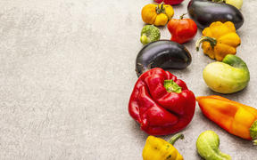 Trendy ugly organic vegetables. Assortment of fresh pepper, eggplant, cucumber, tomato, pumpkin. Cooking ugly food concept. Stone concrete background, copy space