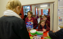 Breakfast club queue: Pupils at Stoke School line up for breakfast, provided free with the help of sponsorship and volunteers.