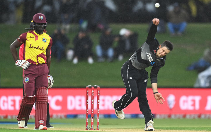 Hamish Bennett bowls in the rain during the New Zealand Black Caps v West Indies match.