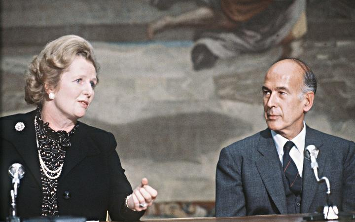 (FILES) This file photo taken on September 19, 1980 shows then Britain Prime Minister Margaret Thatcher talking with then French President Valery Giscard d'Estaing during the 5th France-Britain summit at the Elysee Palace in Paris.