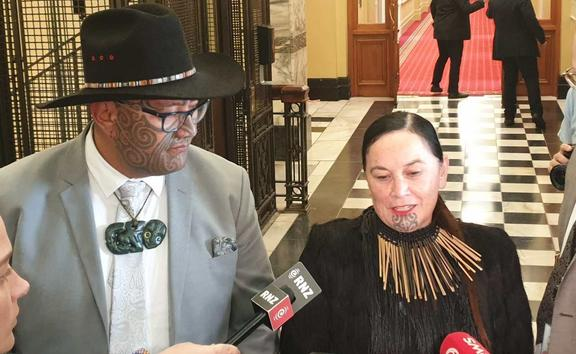 Māori Party MPs Rawiri Waititi and Debbie Ngarewa-Packer speak to media after leaving the debate chamber in protest.