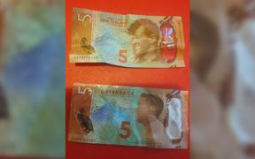 A real $5 note (top) and a fake $5 note given out at the Safety Warehouse promotion.