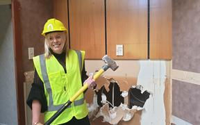 Melissa Vining was the first to strike the sledgehammer.