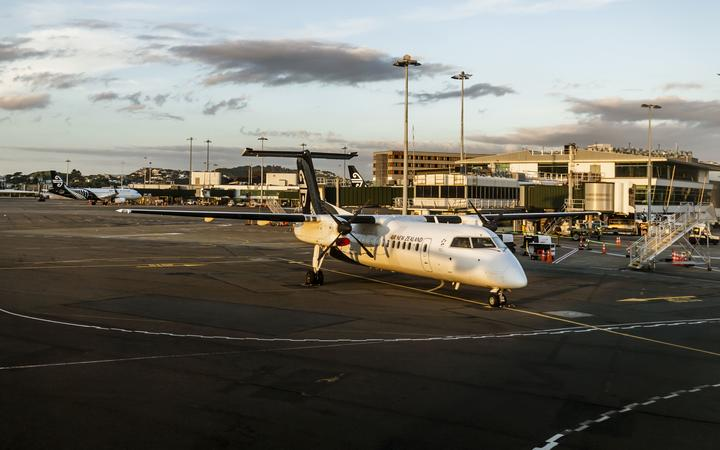 Wellington, New Zealand - January 04, 2019: Aeroplane at the Wellington terminal gate ready for takeoff during sunset on Wellington, New Zealand.