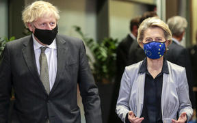 Britain's Prime Minister Boris Johnson is welcomed by European Commission President Ursula von der Leyen at the EU headquarters in Brussels.