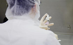 Photo dated December 9, 2020 courtesy of Mount Sinai Health System in New York shows a lab technician during a dry run at Mount Sinai hospital ahead of an expected Pfizer COVID-19 vaccine shipment over the weekend. -