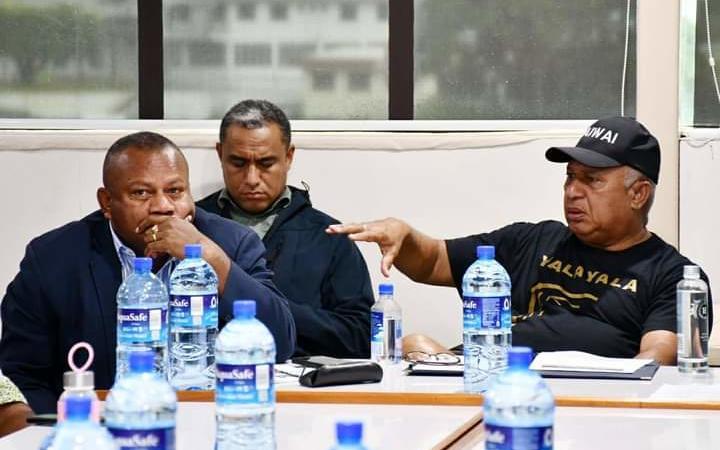 Fiji Prime Minister Frank Bainimarama, right, and Minister for Disaster Management Inia Seruiratu.