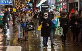 Shoppers walk along Oxford Street as new coronavirus restrictions, announced today by British Prime Minister Boris Johnson, are due to take effect from midnight on Sunday