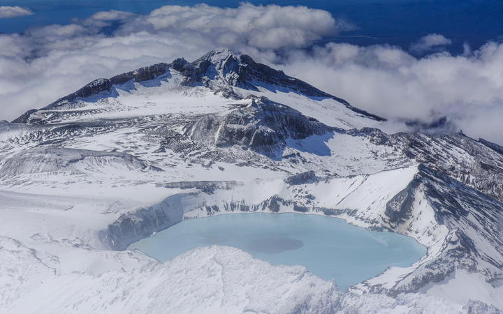 Aerial of a tuquoise crater lake on top of Mount Ruapehu, Tongariro National Park, UNESCO World Heritage Site, North Island, New Zealand, Pacific