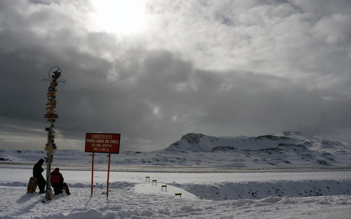 Two Chilean marines take a rest at Chile's military base Presidente Eduardo Frei, in the King George island, in Antarctica, on March 13, 2014.