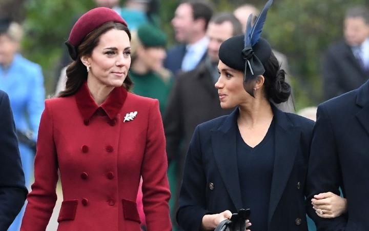 Britain's Catherine, Duchess of Cambridge (L) talks to Meghan, Duchess of Sussex as they arrive for the Royal Family's traditional Christmas Day service at St Mary Magdalene Church in Sandringham, Norfolk, eastern England, on December 25, 2018.