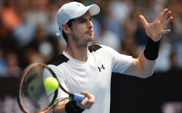 Andy Murray returns against David Ferrer at the 2015 Australian Open in Melbourne, January 27, 2016. AFP PHOTO / SAEED KHAN