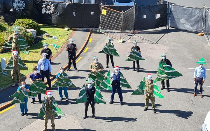 Staff at MIQ in Rotorua's Sudima socially distance with festive cheer on Christmas.