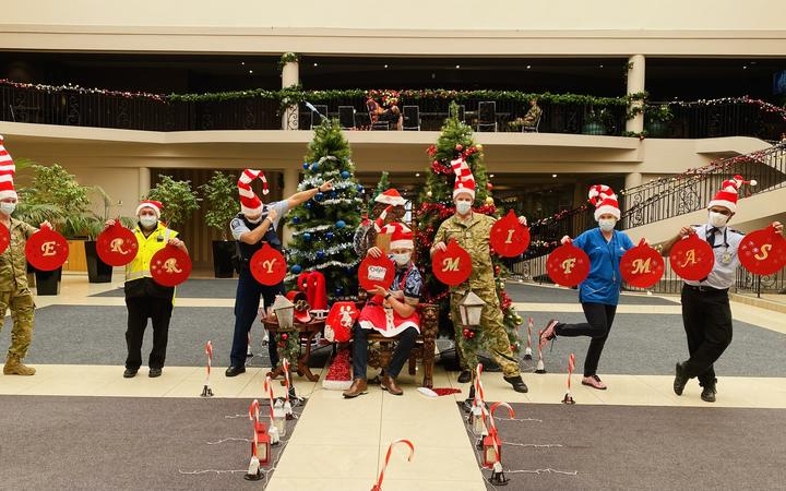 Staff at MIQ in Rotorua's Rydges spread the festive cheer.