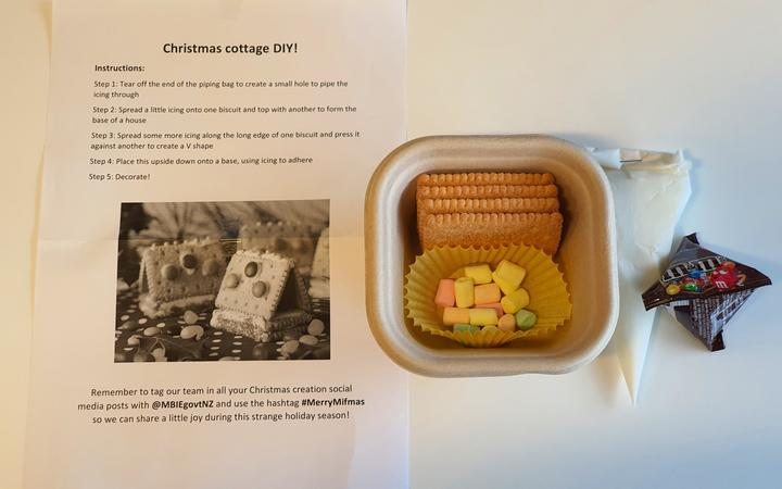 Guests at MIQ facilities were given a little kit to build their own mini-cottages for Christmas.