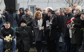 People pay tribute during a ceremony of a foundation stone for a future memorial and the square to memory the victims of the Ukraine International Airlines flight PS752 plane crash, at the Boryspil International Airport near Kyiv, Ukraine, on 17 February, 2020.