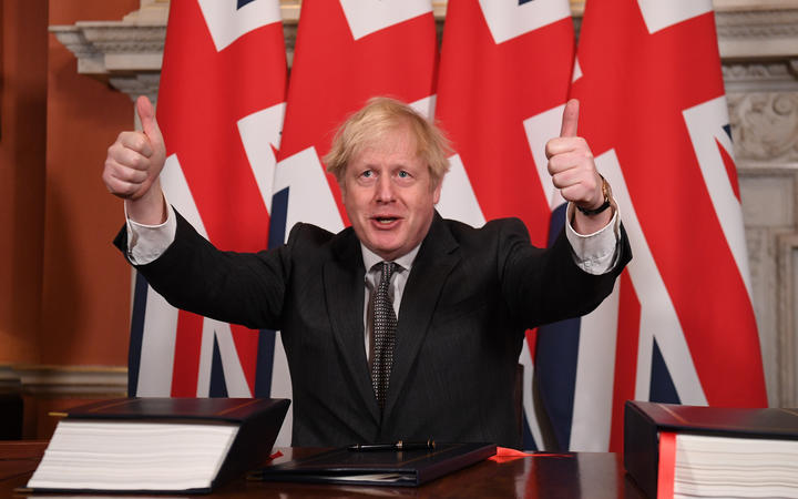 Boris Johnson gives a double thumbs up after signing the Trade and Cooperation Agreement between the UK and the EU, the Brexit trade deal, at 10 Downing Street in central London on 30 December  2020.