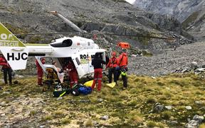 The injured climber being loaded on to the helicopter